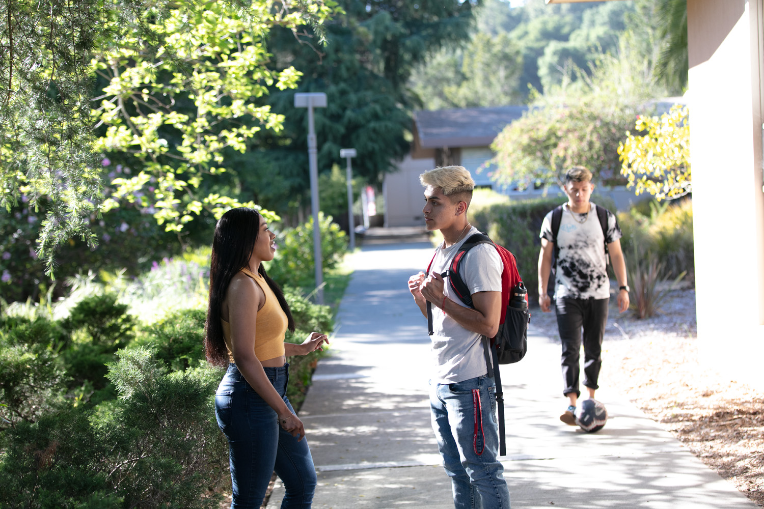 two Holy Names University students talking on campus