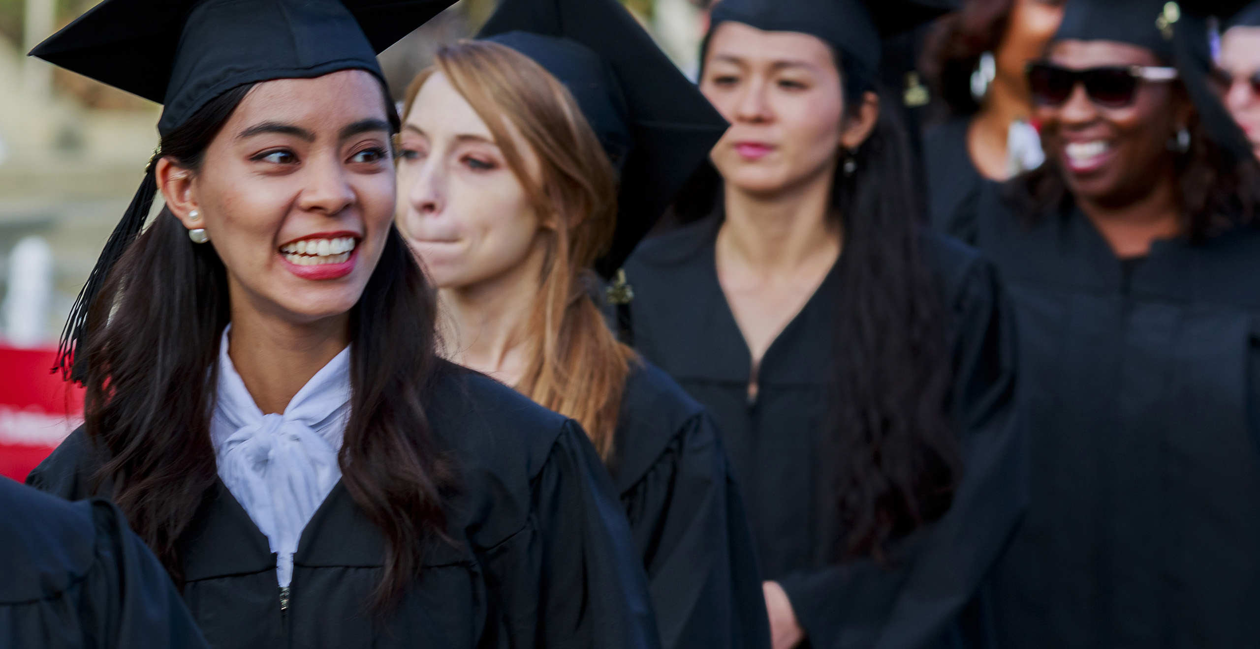 Holy Name University students walking in line for graduation