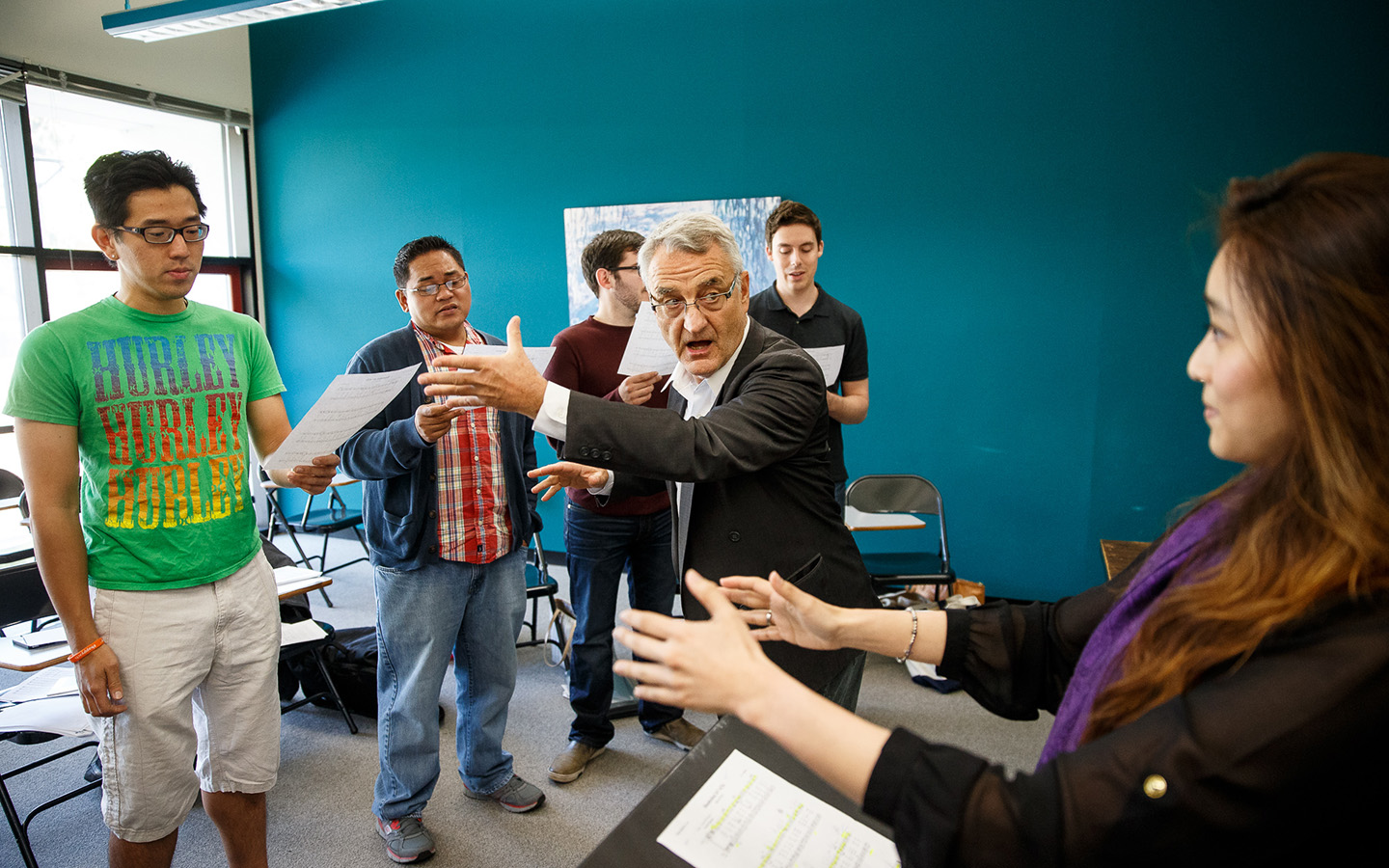 Students and professors engaging in music classroom