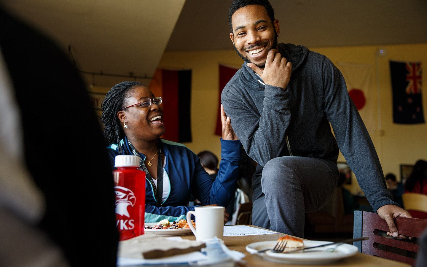 Two Holy Name University students eating lunch in Cafeteria
