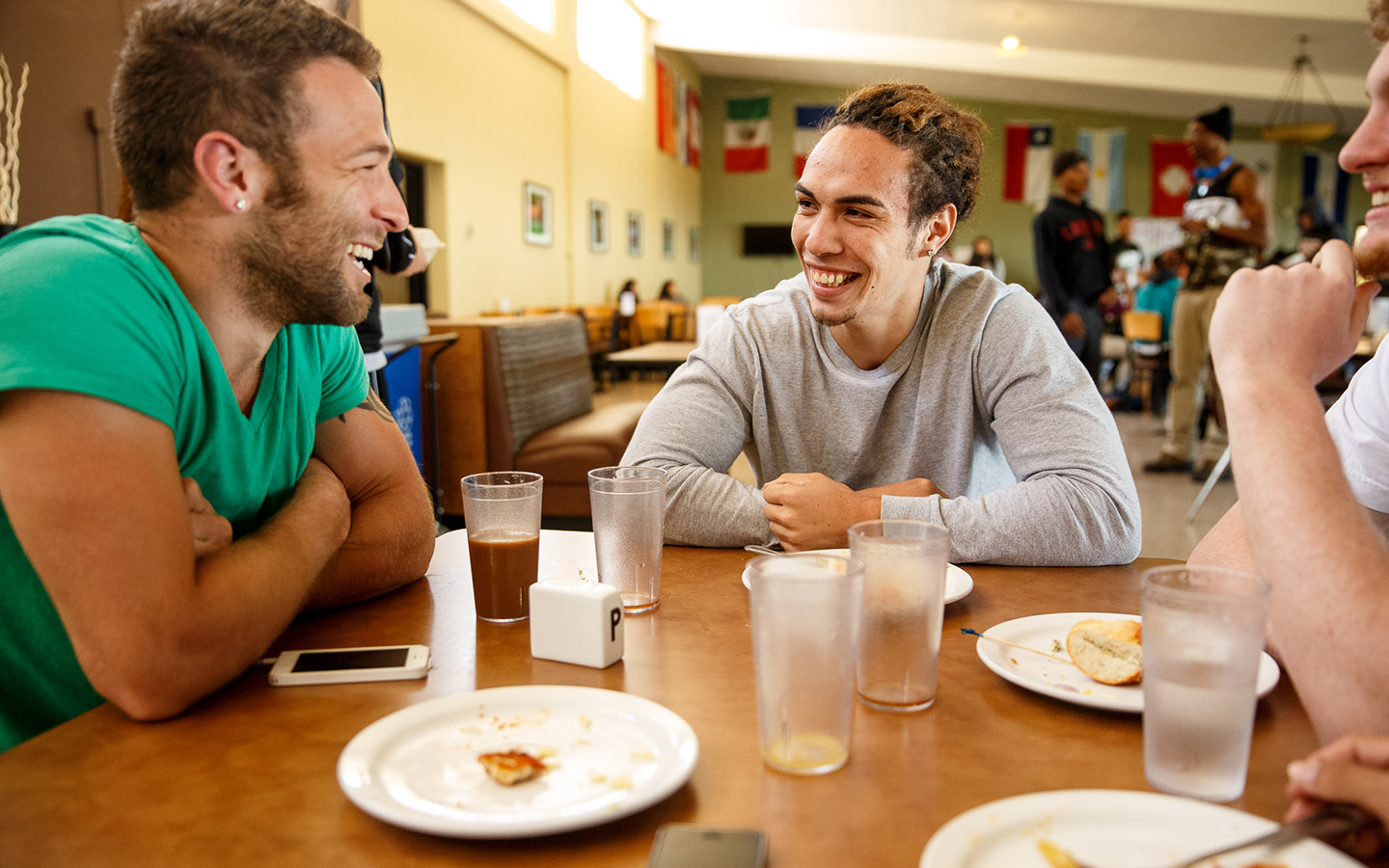 Two Holy Name University students laughing and enjoying lunch