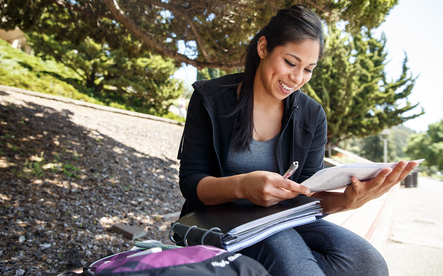 Woman studying on campus steps