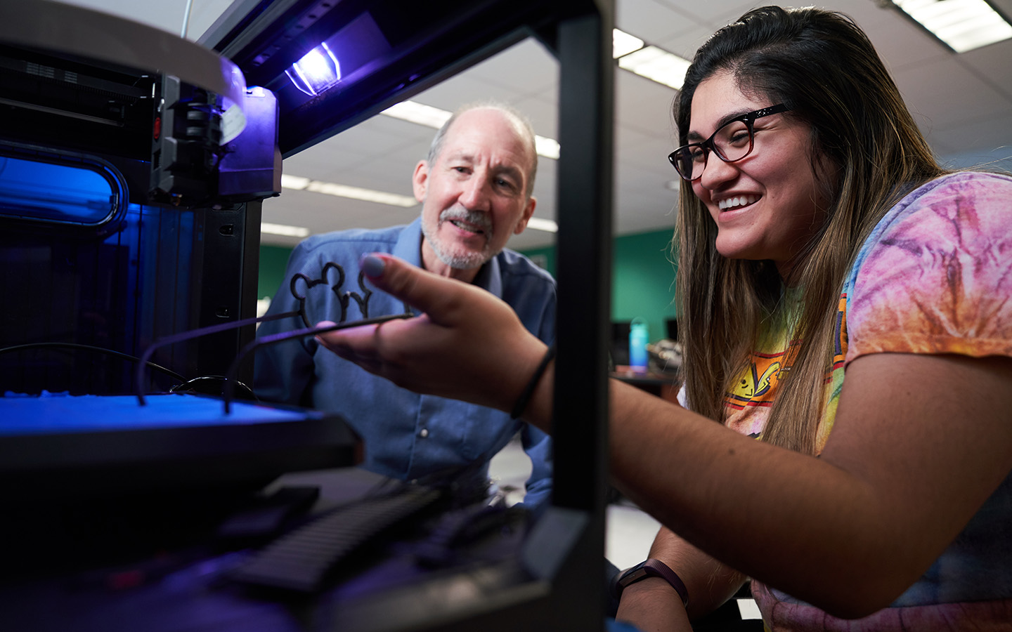 Holy Names University student and teacher with 3D printer