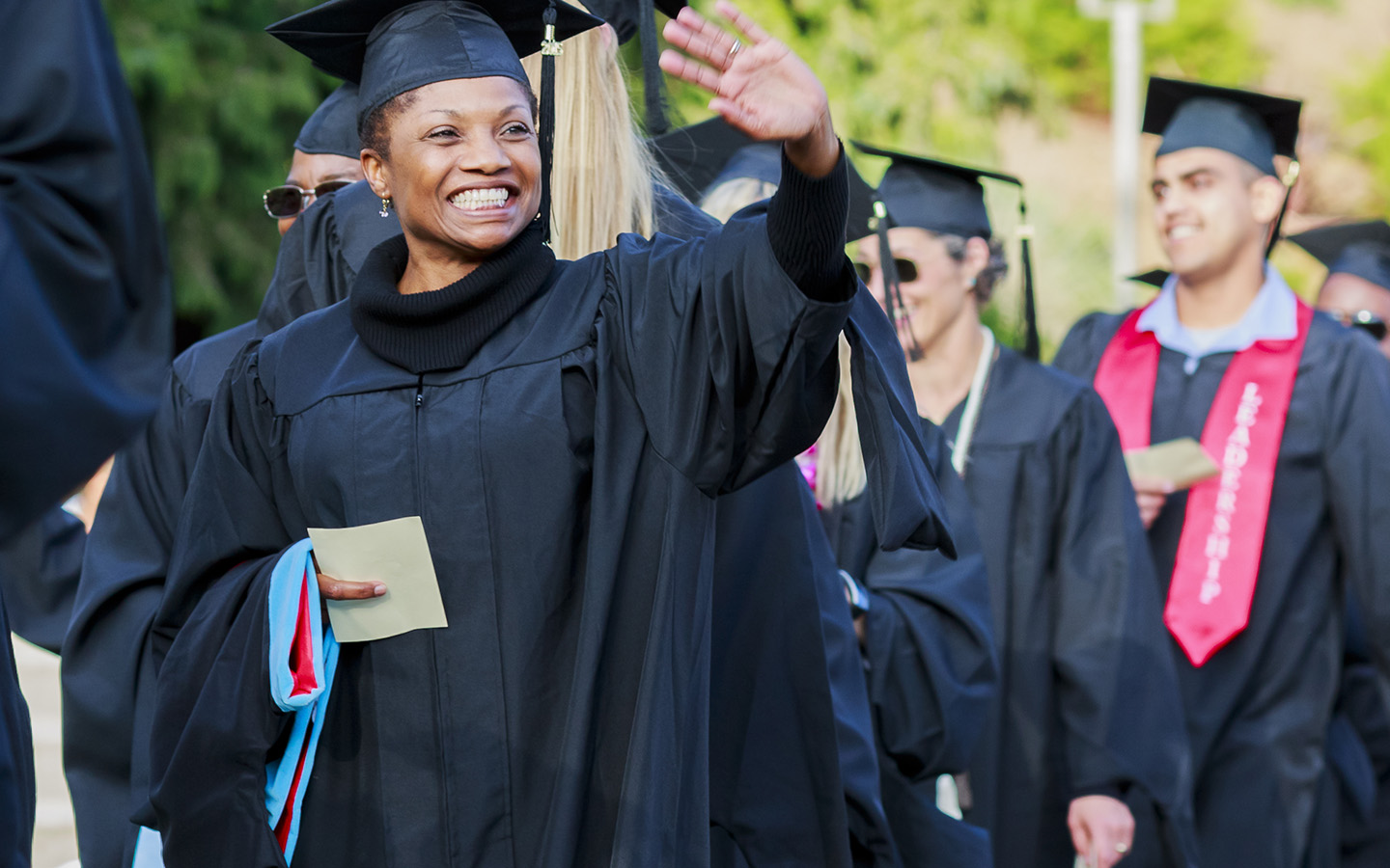 Professors and students walking in line for HNU graduation ceremony