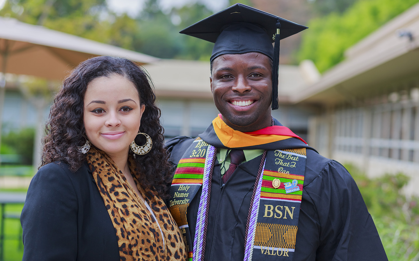 HNU Student posing for photo at commencement ceremony