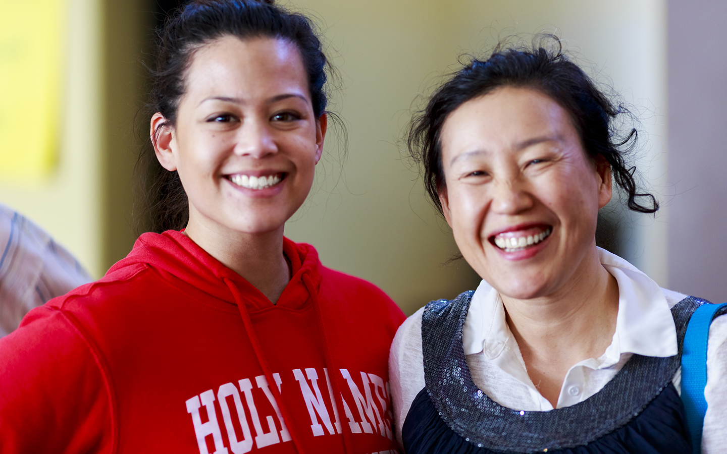 two Holy Names University students smiling
