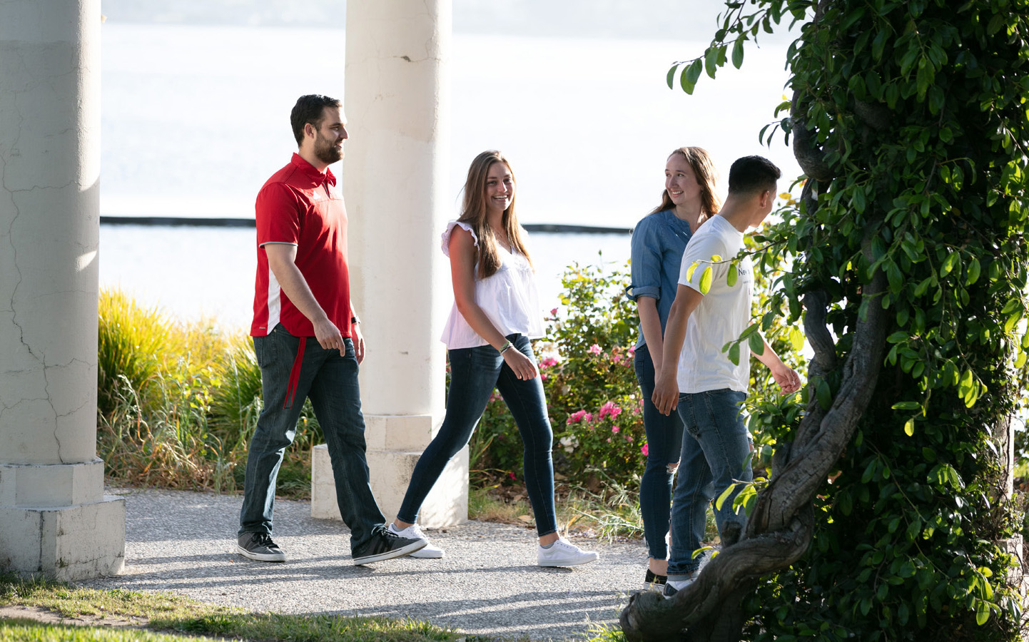 four Holy Names University students walking riverside in Oakland, CA