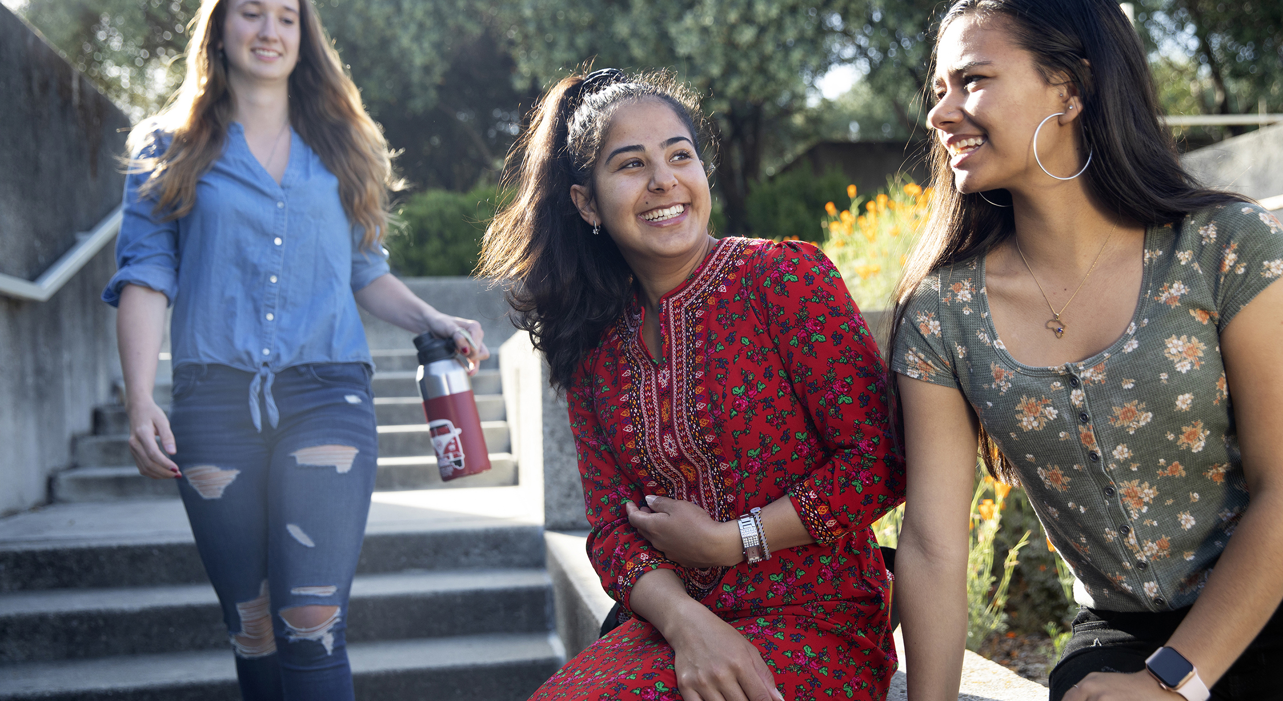 Holy Names University students laughing on campus steps