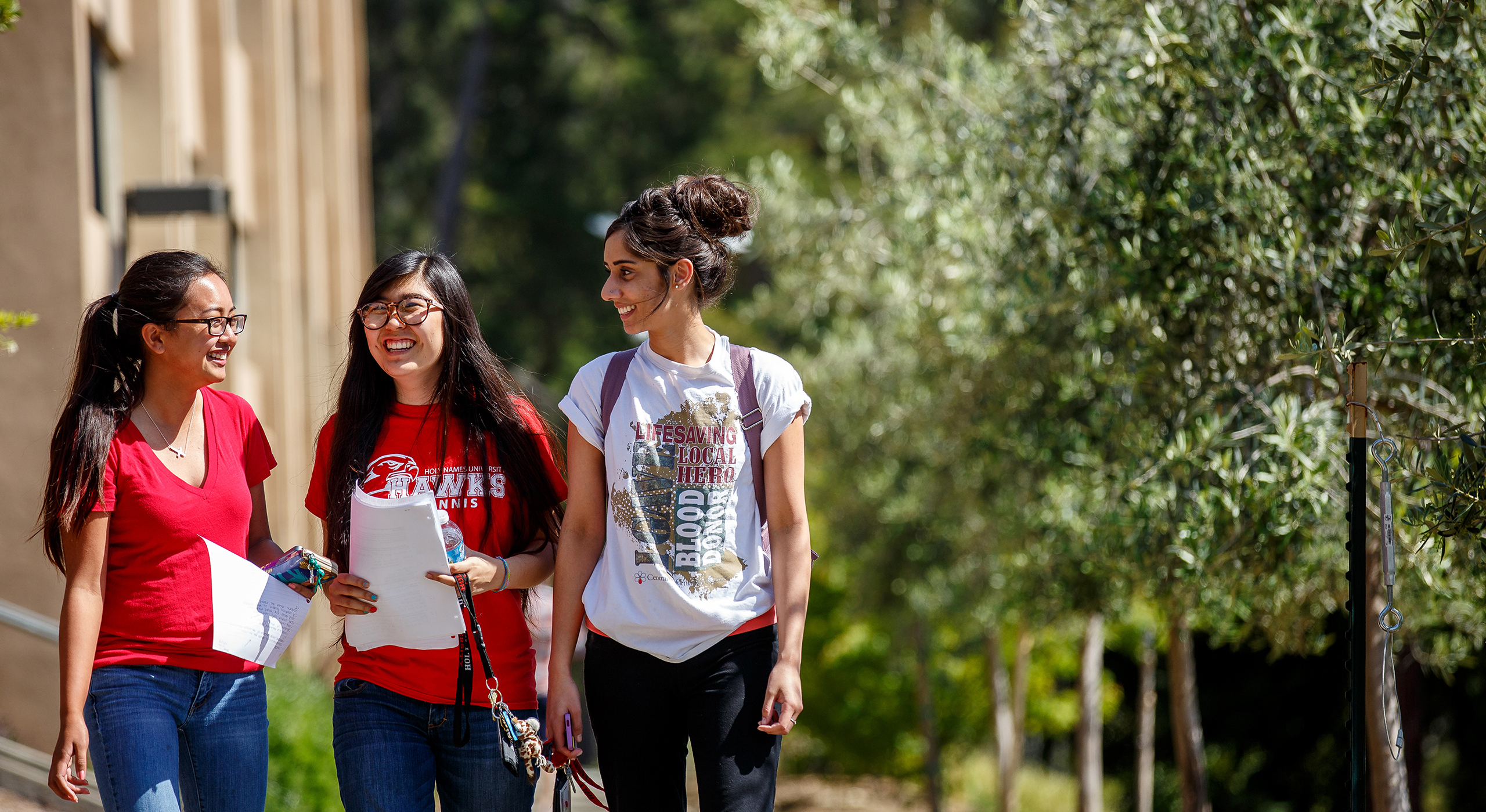 three Holy Names University Education Specialist credential program students walking on campus