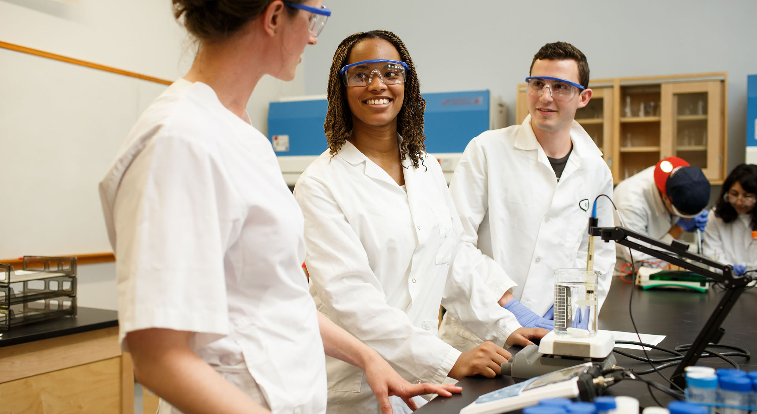 three bachelor degree completion students in science classroom at Holy Names University