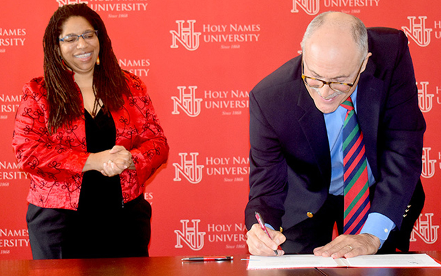 Sheila Smith McKoy and Robert Houghteling signing agreement between HNU and BATTI