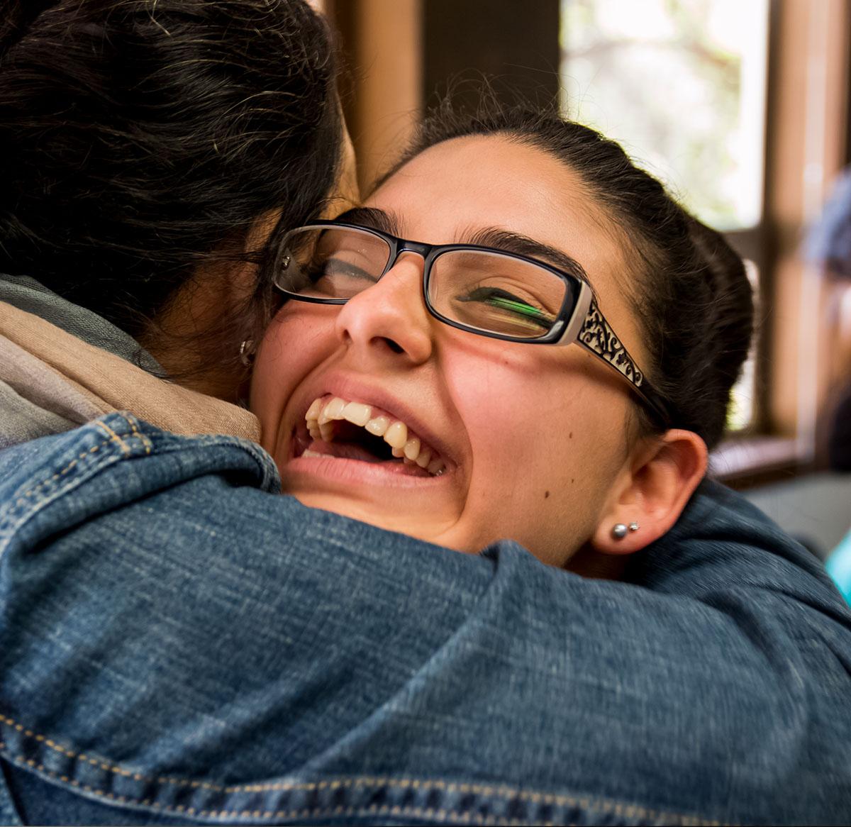 HNU campus ministry students hugging