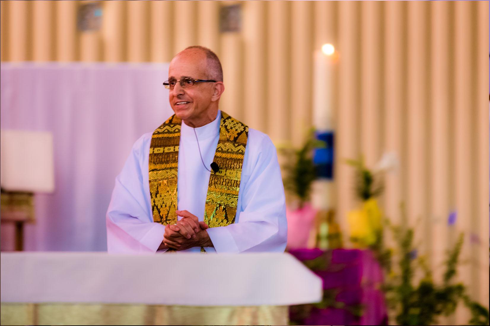 Father Salvatore Ragusa holding mass