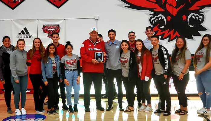 NCAA Commissioner Bob Hogue presenting HNU athletes with PacWest Make-A-Wish award