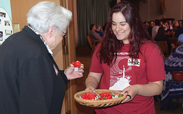 HNU student handing out gifts at Soul Sisters events