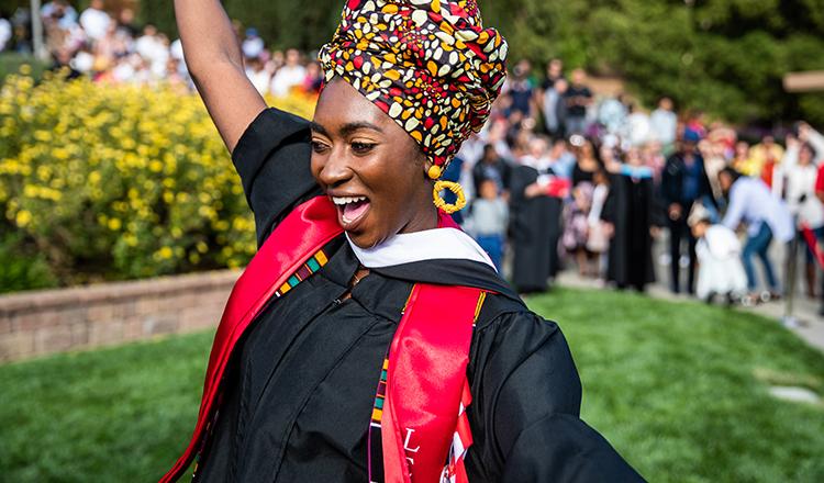 Holy Names University graduate dances happily after graduation