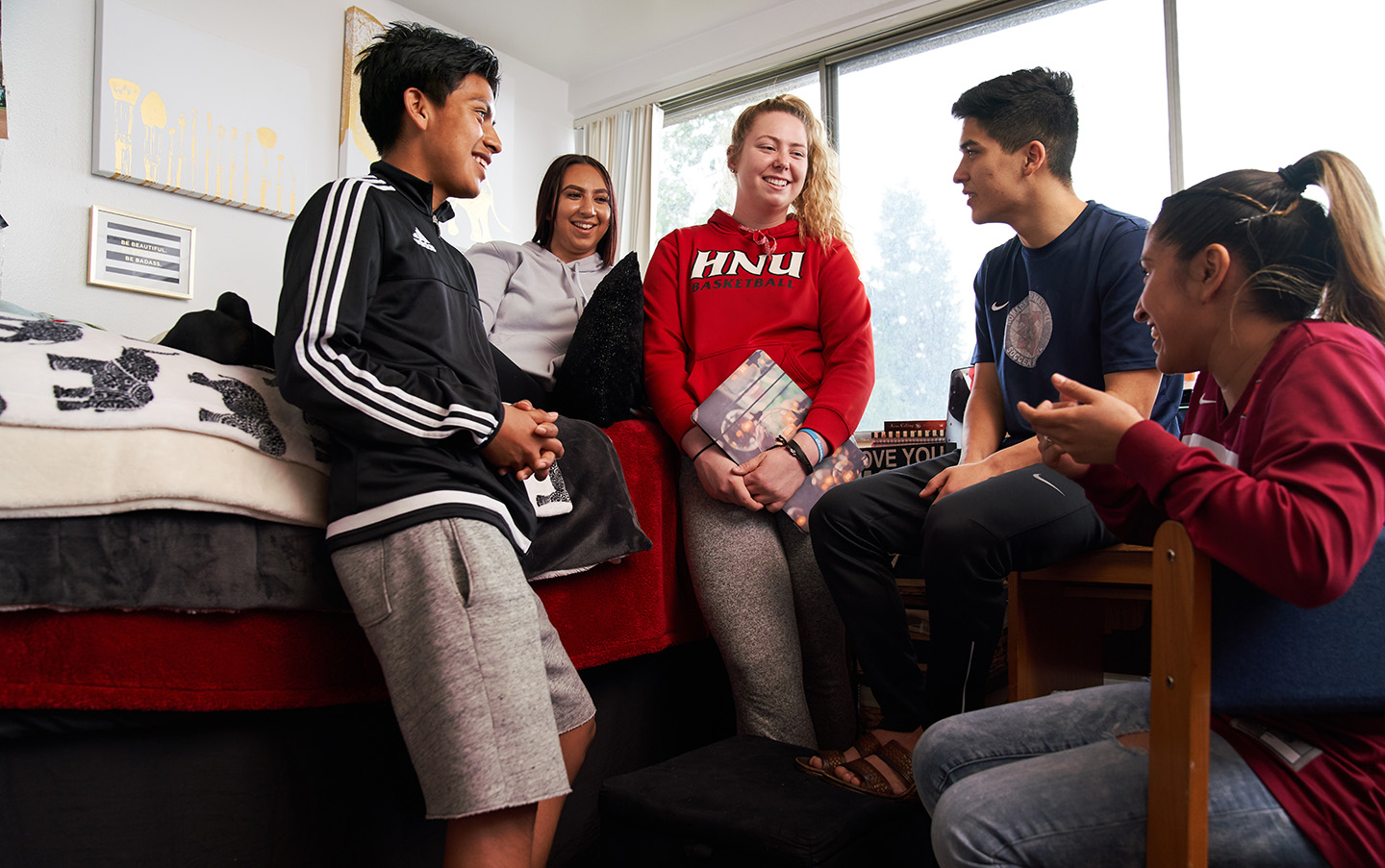 Students laughing in their dorm.