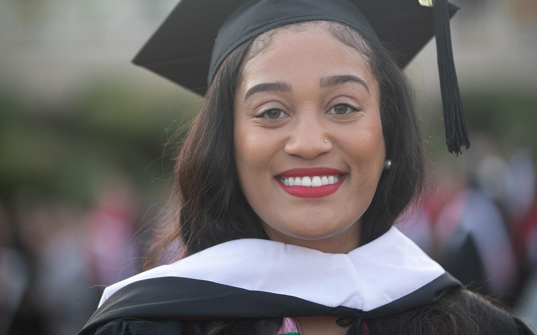 HNU graduate in cap and gown