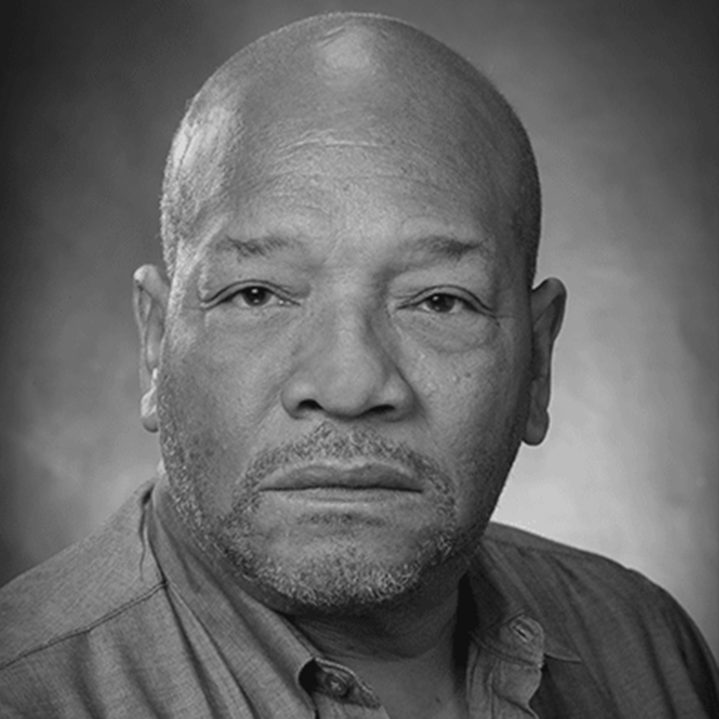 Black and white headshot of Rodney Coates