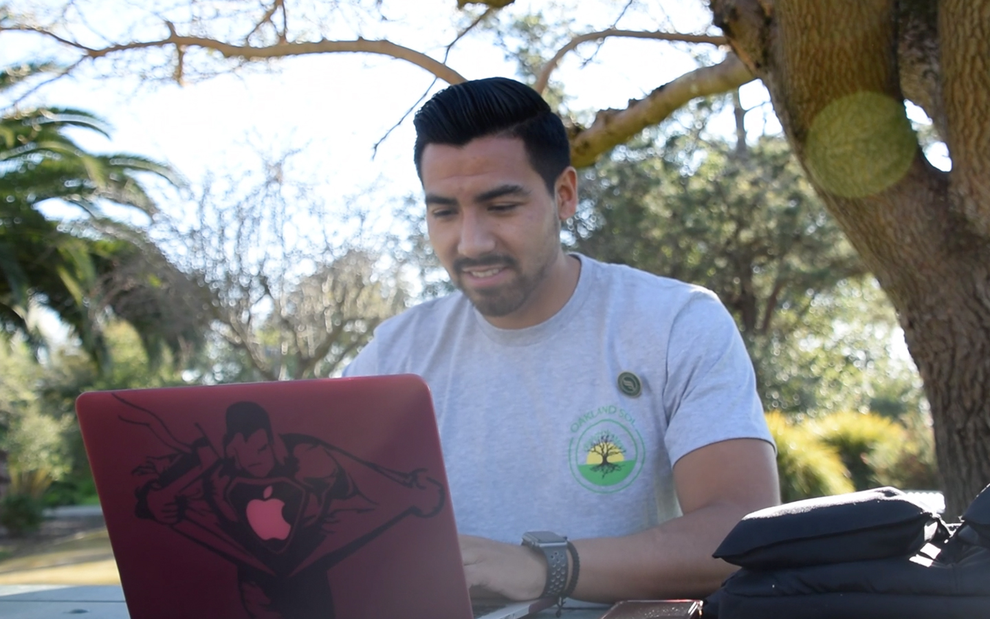 HNU student working on loaner laptop from the loaner laptop program